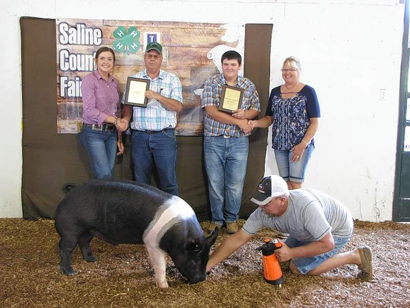 PHOTO COURTESY OF NANCY LAMBERT2019 Swine Bred and Owned Market Champion, Kate Bond, and Market Reserve Champion, Tyler Anderson.  Plaque and prize sponsors are C & B Cattle Company.