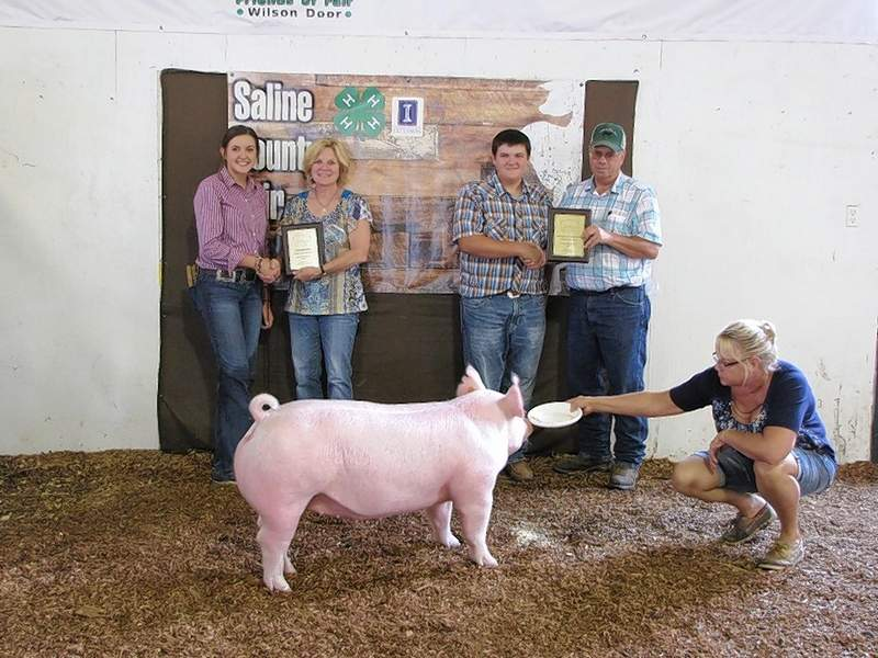 PHOTO COURTESY OF NANCY LAMBERT2019 Swine Bred and Owned Breeding Champion, Kate Bond, and Breeding Reserve Champion, Tyler Anderson. Plaque and prize sponsors are Anderson Crop Insurance and Ron and Carla Bradley.