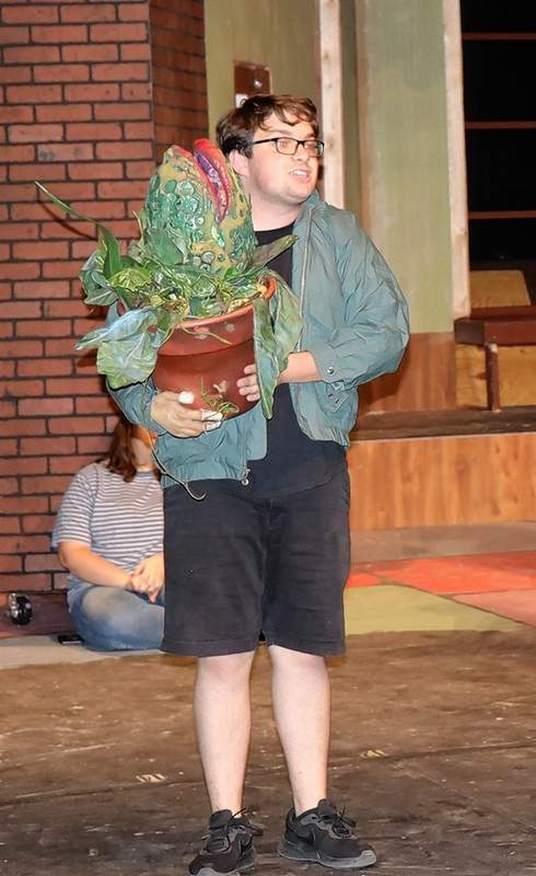 "Seymour carries Audrey II during a scene rehearsal for ""Little Shop of Horrors"", which runs Oct. 5 and 6 at SIC."