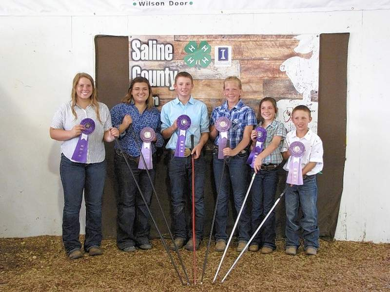 2019 Saline County 4-H Beef Showmanship ribbon winners: (from left) Senior Showmanship Grand Champion, Katherine Smith, Senior Showmanship Reserve Champion, Taylor Hale, Intermediate Showmanship Grand Champion, Tristen Hale, Intermediate Reserve Champion, Shelby Pribble, Junior Showmanship Grand Champion, Caroline Tanner, and Junior Showmanship Reserve Champion, Braxton Davis.