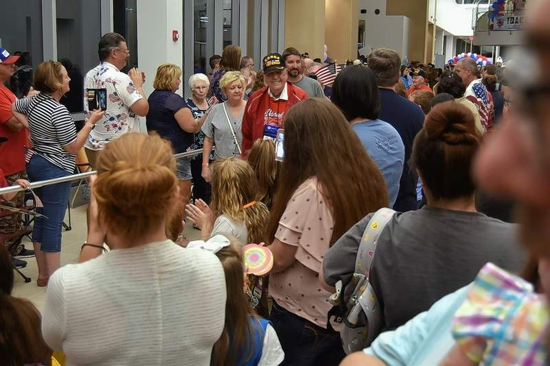 Dan Wilson of Harrisburg, a Korean War Air Force veteran, is joined by family members as the crowd thanks him for his service at Honor Flight's return Tuesday night.