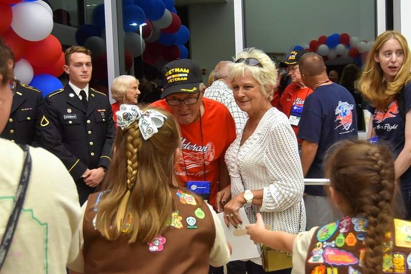 Gary Stricklin of Harrisburg, a Vietnam War Army veteran, is thanked for his service by Girl Scouts at Honor Flight's return.