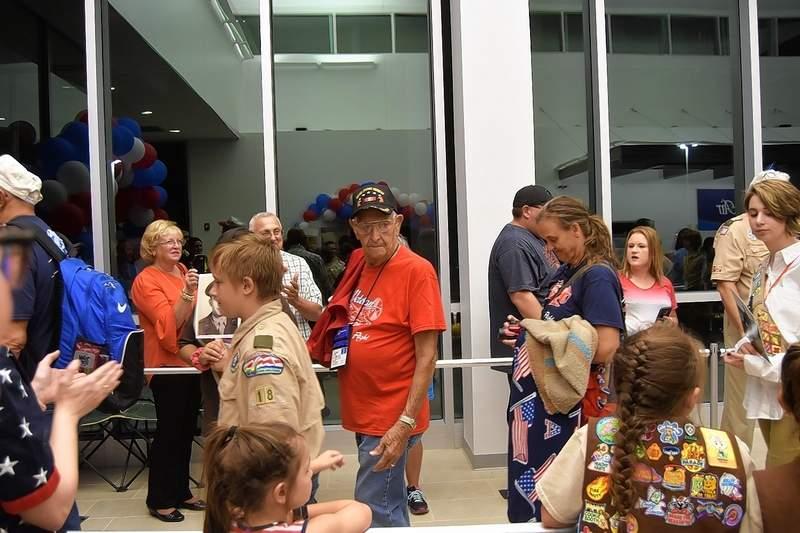 Paul Brockschmidt, an Eldorado Army veteran, is thanked by the crowd during Honor Flight's return.