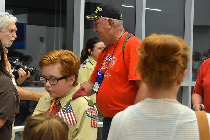Ralph Gass of Eldorado, a Vietnam War Army veteran, is thanked by crowd members during Honor Flight's return.