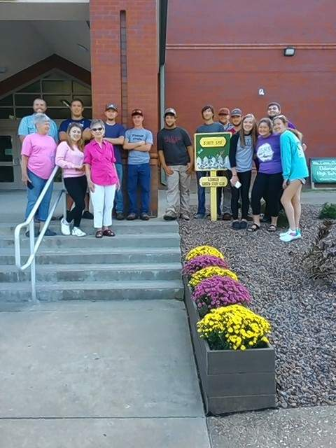 The Eldorado Garden Study Club spot for September was Eldorado High School on Illinois Avenue. Kaleb Irwin, agriculture and FFA club sponsor, and his FFA club and students landscaped the entrance to the school with shrubbery and flower boxes filled with purple and gold mums. Pictured is Irwin and his FFA students along with high school principal Cody Cusic and garden club members Dixie Long and Susan Justice.
