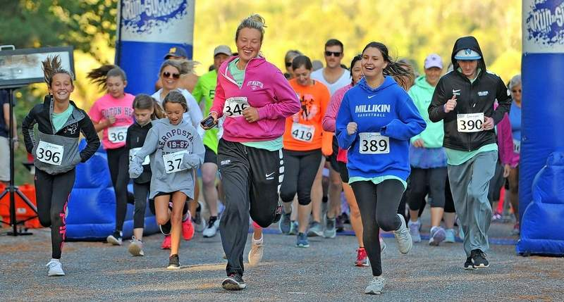A half-marathon and 5K run were held Saturday morning at Sahara Woods to benefit Teresa Hathaway, right, who is currently undergoing cancer treatment.
