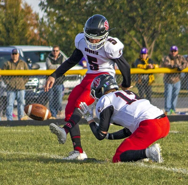 Kicker Alec Caldwell makes the extra point after Du Quoin's first half touchdown.