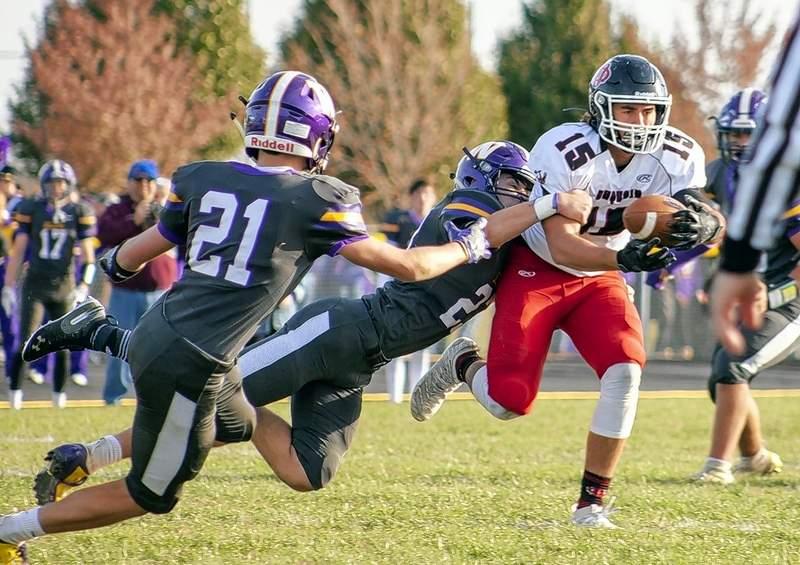 A Williamsville defender tries to haul down Indian running back Lane Bauman.