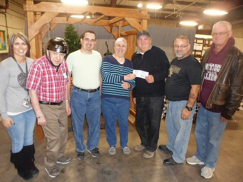 From left are Five Star representatives Danielle Ridgeway, Day Program Manager Gerry Lang, Bruce Wheatley and Leslie Dalton; followed by Knights of Columbus Rick Eisenhauer, Don Eisenhauer and Bob Schleper.