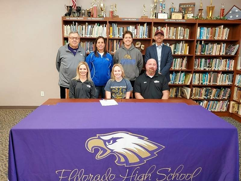 Paige Munds signs to play softball at SIC during the 2020-21 collegiate season. Pictured sitting (l-r) are mother, Tara Munds; Paige Munds and father Jim Munds. Standing (l-r) Eldorado High School Softball Head Coach, Rick Dempsey; SIC Softball Assistant Coach, Missy Broy; SIC Softball Head Coach, Maggie Calcaterra and Travel Ball Coach, Rich Campbell.