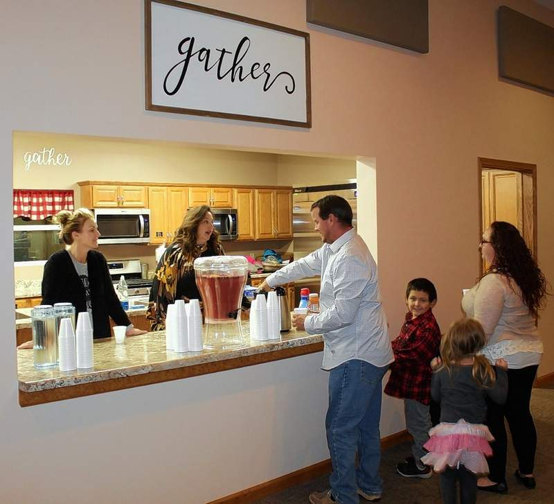 Liberty Church members serve refreshments to families and friends following the Community Service.
