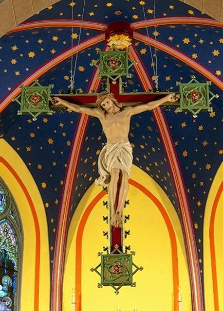 The figure of Christ on the cross, suspended.