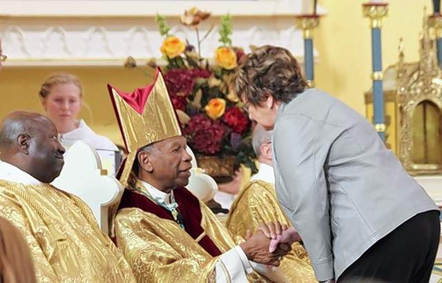 Janet Vasquez introduces herself to Bishop Edward Braxton, of the Belleville Diocese.