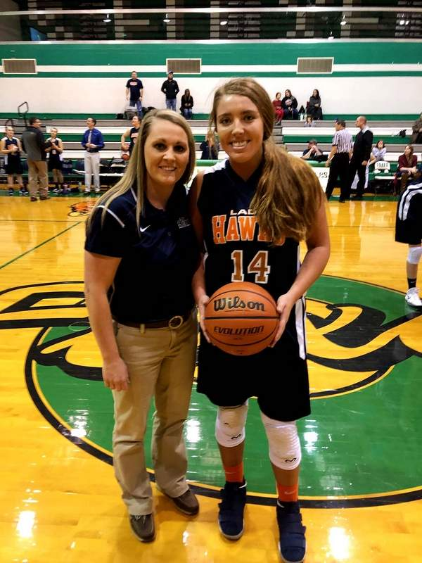 Gallatin County's Audrey Jackson, pictured with head coach Tiffany Sauls, went over the 1,000th point plateau Saturday at the Hamilton County Invitational. Jackson was also named to the All-Tournament Team.