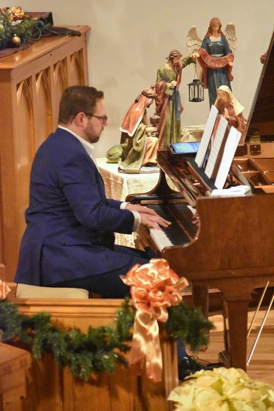 Cody Sandusky plays piano during The Penguins' musical performance Monday night.