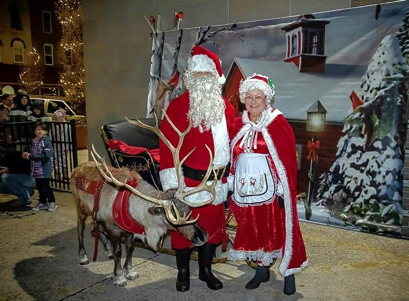 Mr. and Mrs. Claus during a rare break in the action.