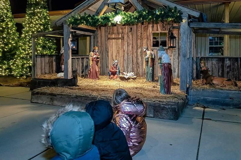 Father Joseph Oganda blessed the Nativity scene on Main Street. See more photos on page 15.