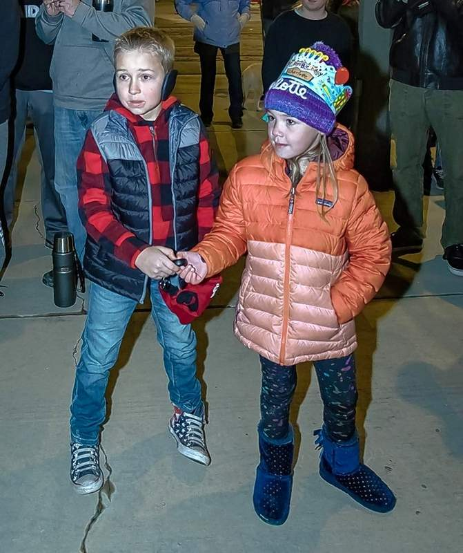 Hayden Jones and Charlotte Furlow got the important job of helping to light the Du Quoin community Christmas tree Monday night.