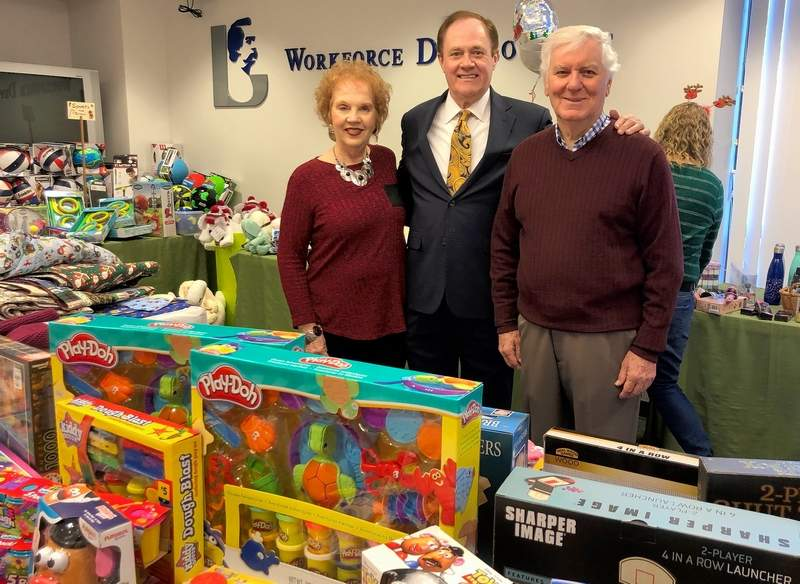 "From left, Jo Poshard, Richard Clark, and Glenn Poshard stand amid the hundreds of toys waiting to be matched with children ""not on anybody's list."""