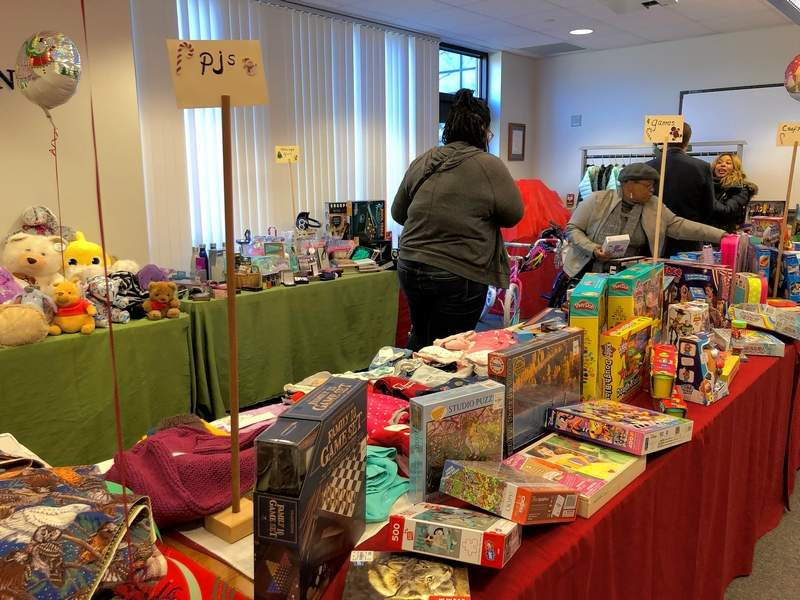 "Social workers ""shop"" to fill lists for children who are victims of abuse, neglect, and abandonment at the Poshard Foundation annual Christmas toy giveaway at John A. Logan College on Wednesday."