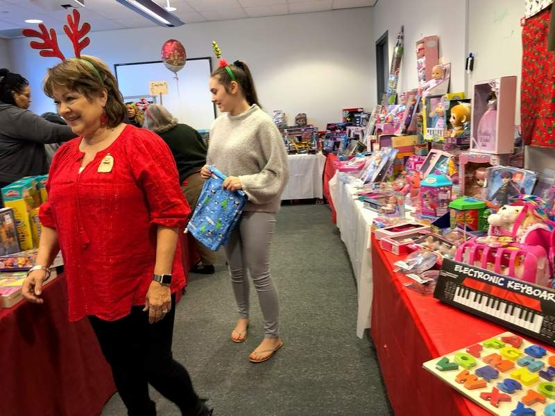 "Carol Haven, front, and her granddaughter, Jayden, are two ""elves"" who help make the Poshard Foundation toy project a success."