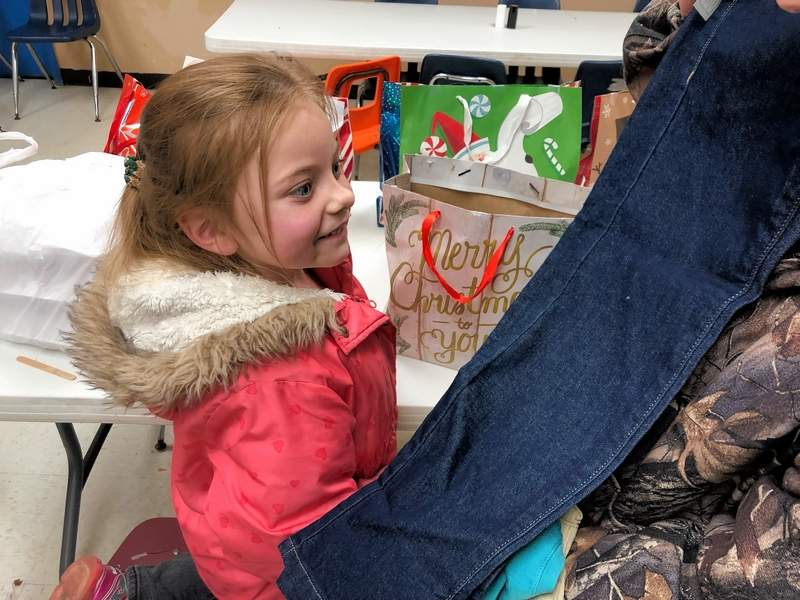 Santa came early to drop off gifts for Emily DeMarco, whose face expressed her joy at the new clothes, compliments of the Fowler Bonan Foundation's Clothes for Kids.