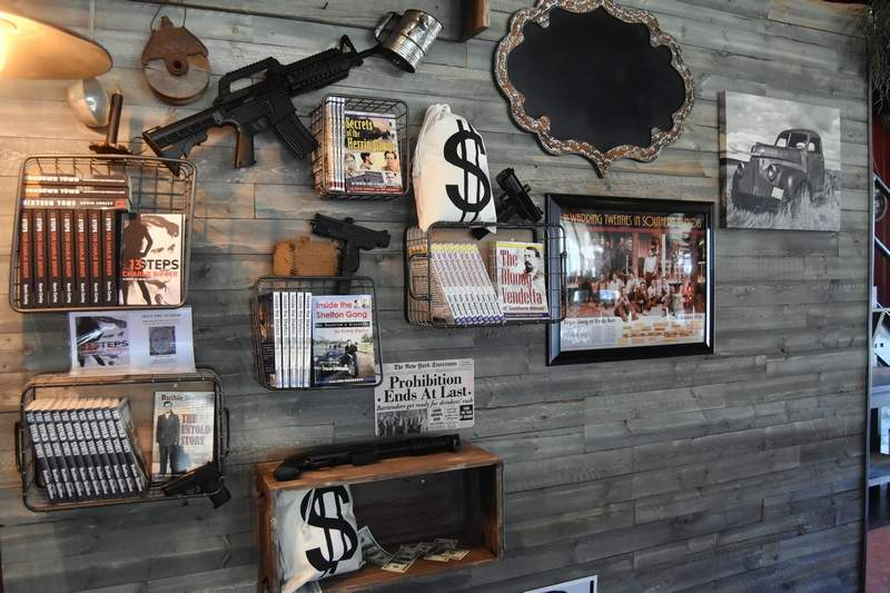 Local Prohibition wall decorations and novels about the region's gangster history adorn a wall.