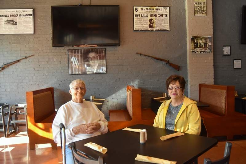 Harrisburg residents Jim and Ann Heffington wait to be served shortly after the opening of Southern Outlaws Bar and Grill Tuesday.