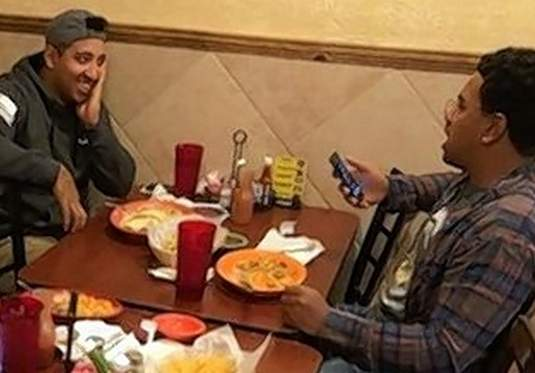 Marshall Anderson, left, enjoys a meal and conversation with his family, including his brother, Isaiah, right, at El Jalisco in Herrin recently. Anderson deployed as part of Operation Freedom's Sentinel on Tuesday.