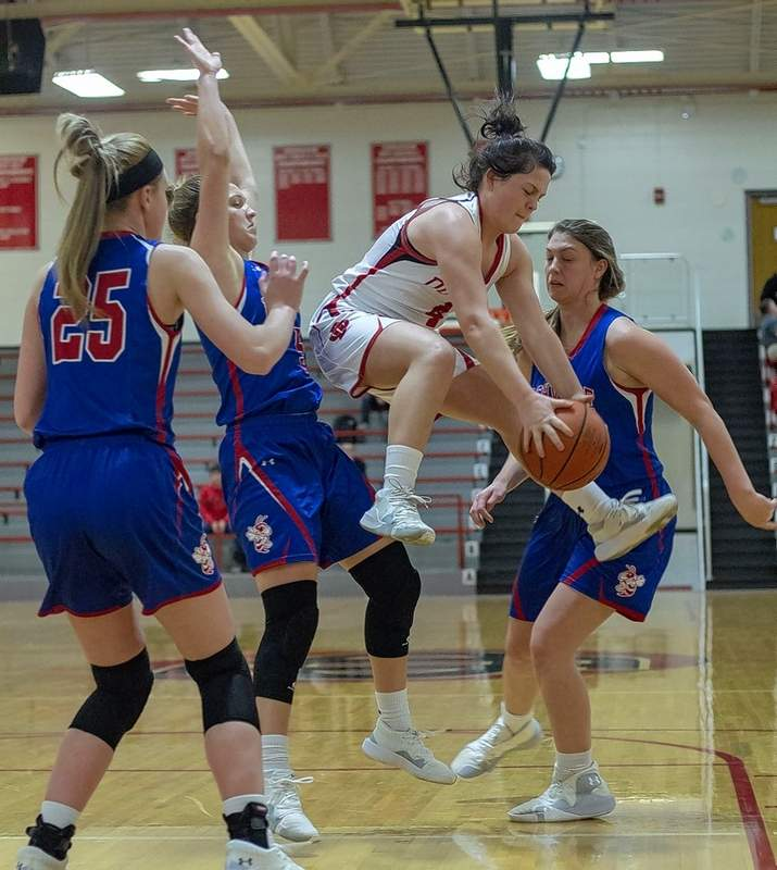 Bailey Harsy leaps to control a loose ball in traffic.