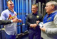 Former St. Louis Cardinals pitcher and outfielder Rick Ankiel, left, shared a laugh backstage with Marion Police Chief David Fitts and Johnston City resident Jimmy Dean Sunday afternoon during an appearance by one of the Cardinal Caravans that included this stop at Marion Cultural & Civic Center.