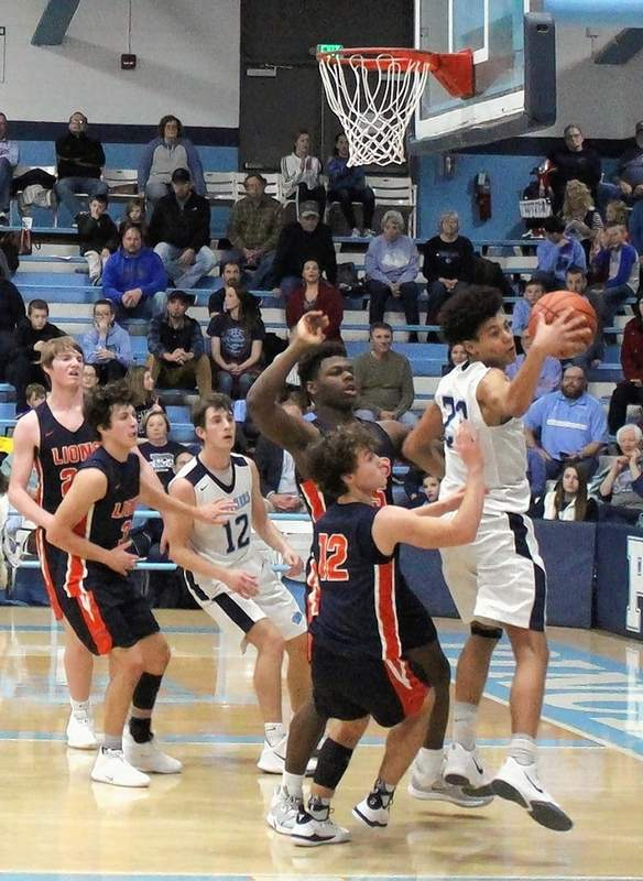 Dré Scott corrals a rebound in traffic during the Panthers' big 3rd quarter against Carterville.