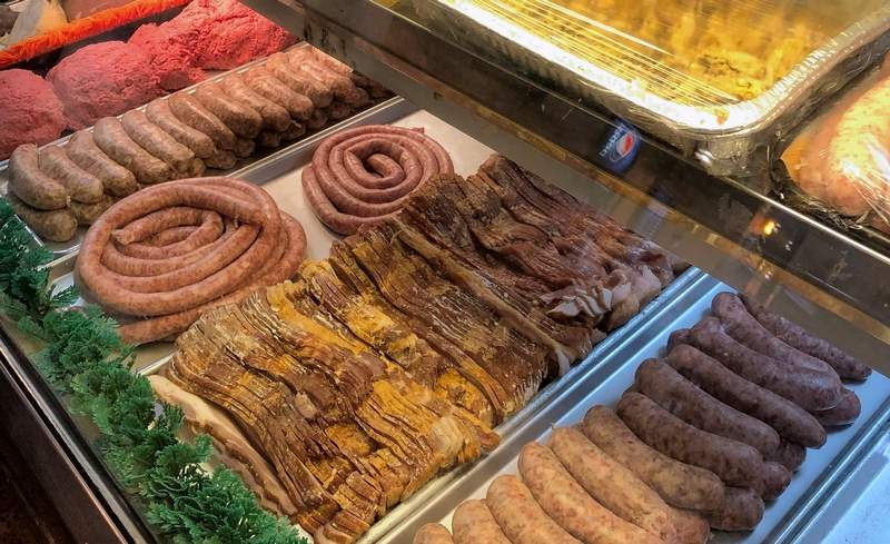 A variety of fresh meat, including store-made salad meats, is always ready for customers who line up daily.