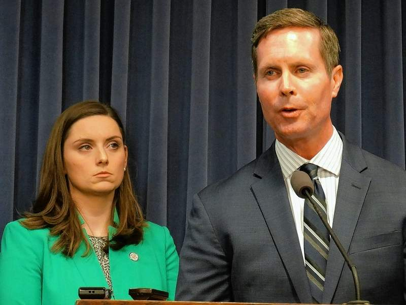 U.S. Rep. Rodney Davis and GOP state Rep. Avery Bourne of Raymond, both Republicans, speak during a news conference Wednesday calling for the state's automatic voter registration program to be paused until officials are certain that non-U.S. citizens are not being registered to vote.