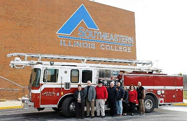 Lake of Egypt Fire District donated a ladder truck to SIC for various programs and events. Pictured (L-R) are Dr. Karen Weiss, SIC Vice President of Academic Affairs; Dr. Jonah Rice, SIC President; Jim Ellis, SIC Board of Trustees Secretary; Frank Huffstutler, Lake of Egypt Assistant Fire Chief; Bobby Williams, SIC Fire Science Instructor; Lisa Hite, SIC Executive Dean of Administrative Services; Lori Cox, SIC Associate Dean of Workforce & Community Education; Ricky Sauls, SIC Career & Technical Education and Special Projects Coordinator.
