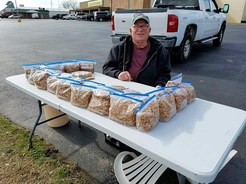 Joe Jackson, a member of Harrisburg First Baptist Church's Men on a Mission, sells pecans at Parker Plaza Monday. The fundraiser is selling Gallatin County pecans for $10 per bag. For more information, call Jackson at (618) 841-5015.