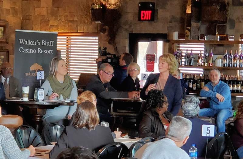 Emily Burke, senior vice president for project development for Walker's Bluff, addresses the crowd gathered for the first of three seminars for local businesses held last Friday.