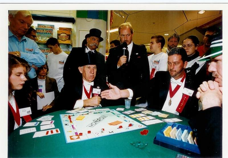 Roger Craig, right, prepares to win the 1995 U.S. Monopoly Championship in New York City in this Associated Press file photo.