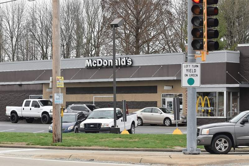 Customers line up in the drive-through of the Eldorado McDonald's.