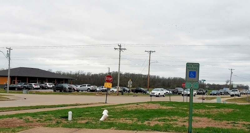 By 3:30 p.m., cars were parked nearly everywhere near Thrive cannabis dispensary in Harrisburg.