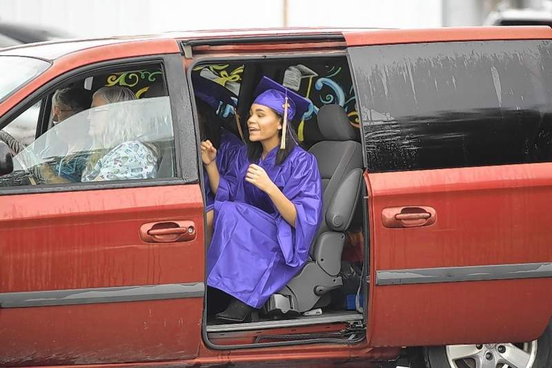 An EHS Class of 2020 grad rides in the graduates parade.