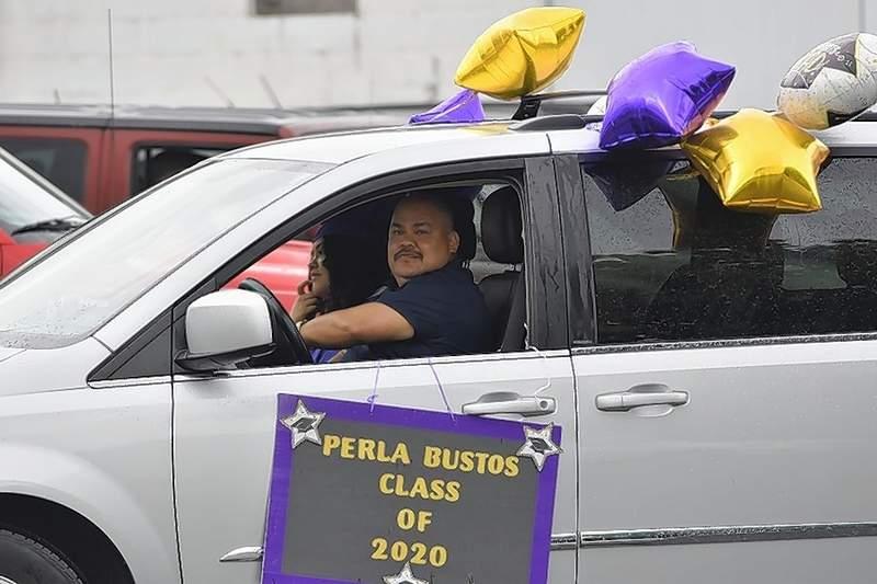EHS Class of 2020 grad Perla Bustos rides in the graduates parade.