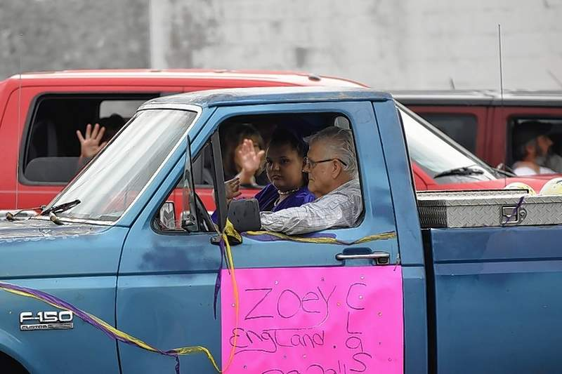 EHS Class of 2020 grad Zoey England rides in the graduates parade.