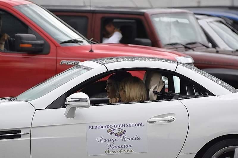 EHS grad Lauryn Brooke Hampton is driven though the graduation parade.