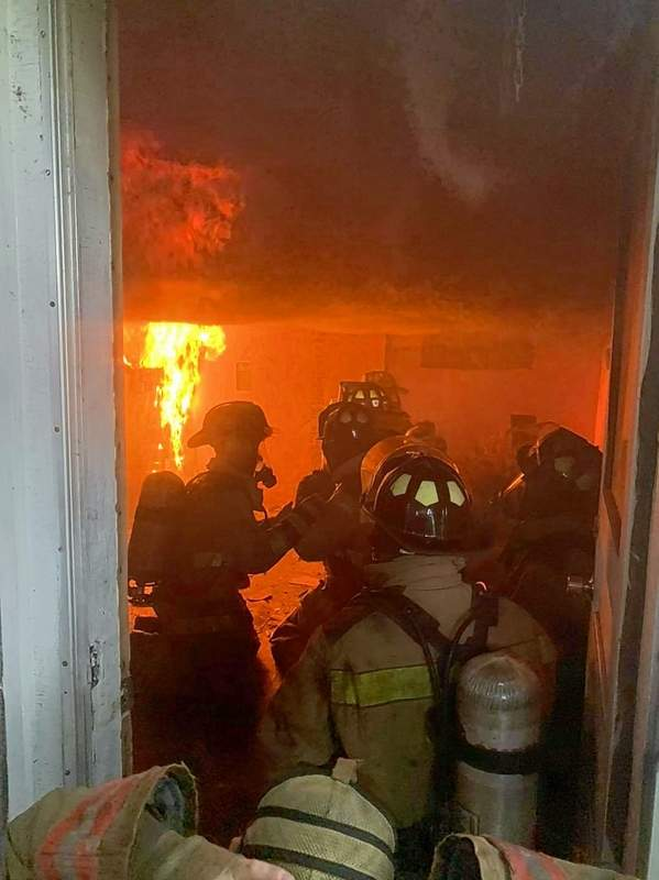 Harrisburg and Carrier Mills firefighters receive live on-site fire training Tuesday.