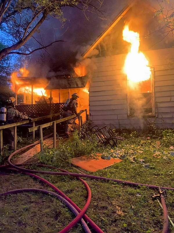 Firefighters work to combat a blaze during fire training Tuesday.