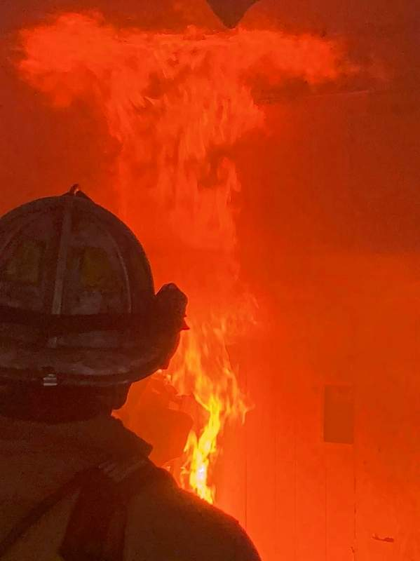 A firefighter faces a blaze during training Tuesday.