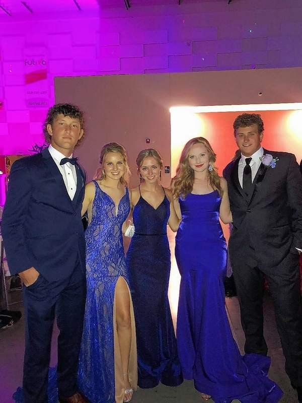 From left, Chase Isbell, Emily Jones, Ashton Randolph, Victoria Shore, and Reece Roper, pause for a photo during the SI Prom held at the Marion Pavilion Saturday night.