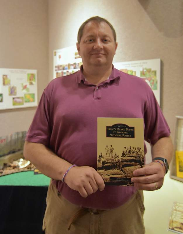 Todd Carr holds a copy of his book about L.O. Trigg after a program at the Cache River Center Saturday.