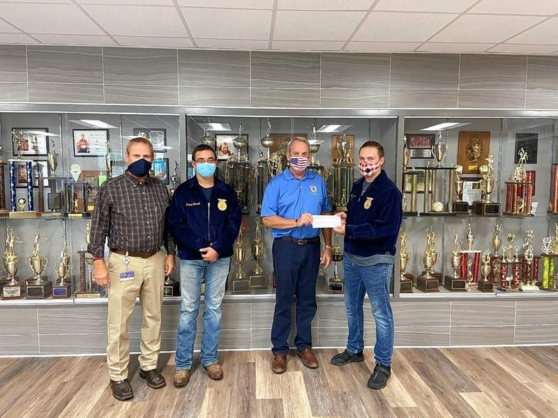 State Sen. Dale Fowler presents a $750 grant to Alexander County FFA.